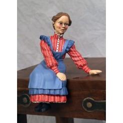 Fru. Karin siddende